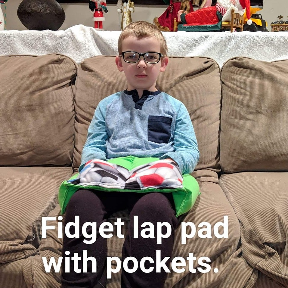 child with lap pad